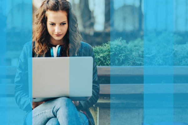 A girl taking an online assessment outdoors