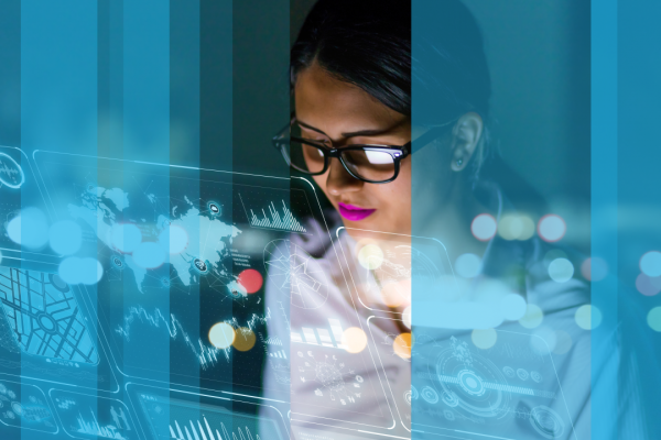 Female scientist looking at futuristic interface uses science to analyse and inform best practice for talent management solutions