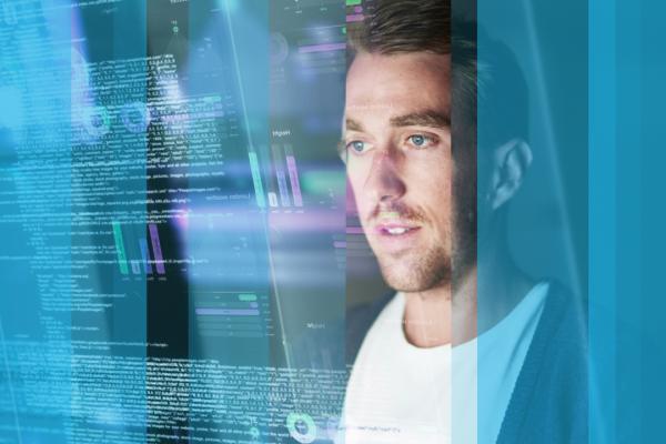 Man looking at futuristic interface showing people analytics data
